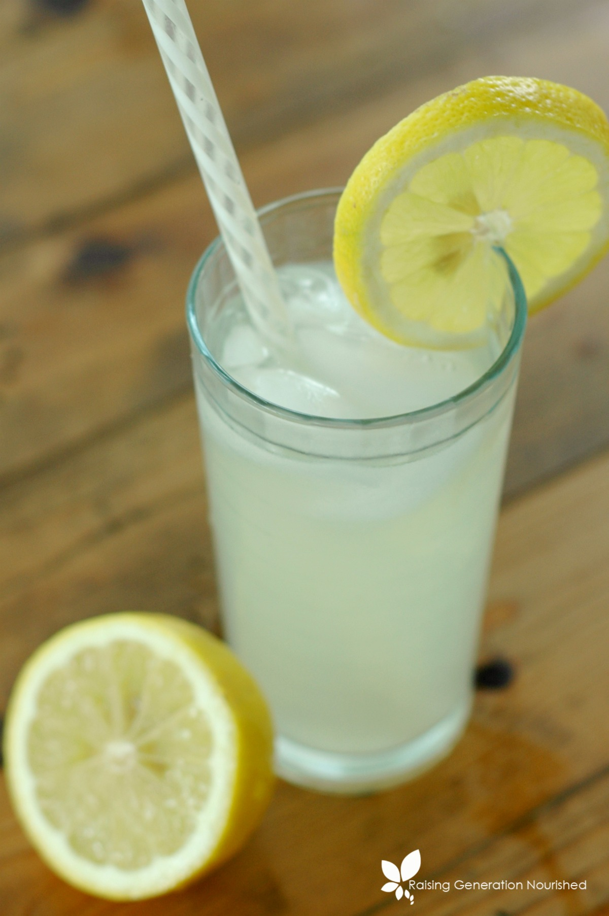 Simple Fermented Lemonade :: Bring that classic summertime drink up a few notches with a big probiotic boost from this simple fermented lemonade! Refreshing *and* nourishing all in one!