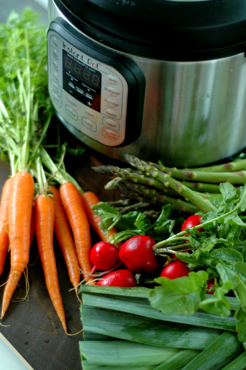 Instant Pot Spring Vegetable Soup :: No chopping prep! Everything into the pot and set for 10 minutes! Enjoy those seasonal spring veggies in a delicious fresh soup perfect for lunch or sipping on in a mug on a cool spring morning!